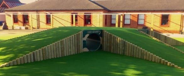 built up wooden tunnel with artificial turf