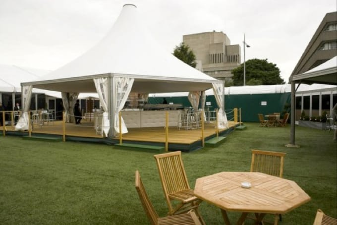 Outdoor Marquee bar with synthetic turf carpet