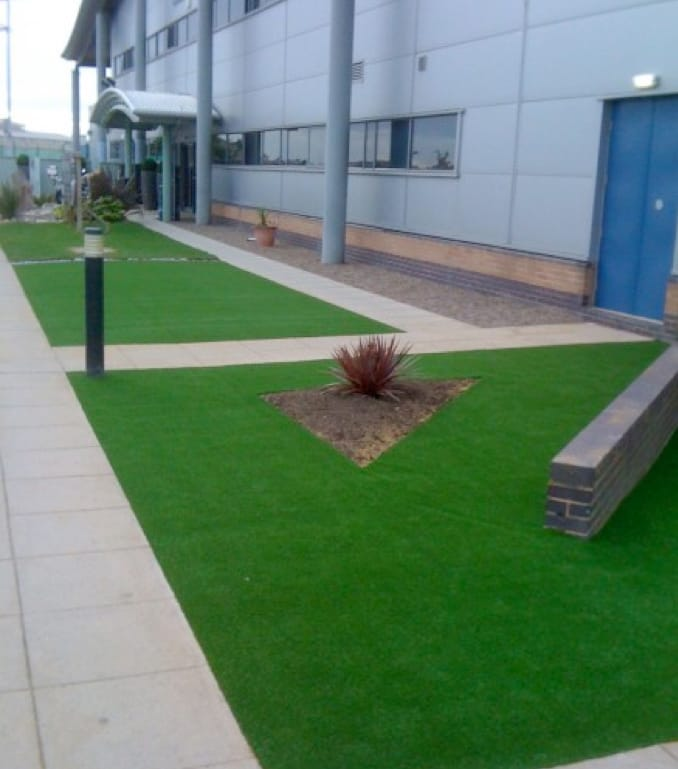 Outside Building with artificial grass border