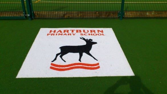hartburn primary school white logo cut into playground surface