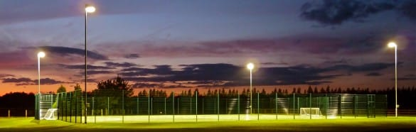 Floodlights on an artificial turf muga pitch