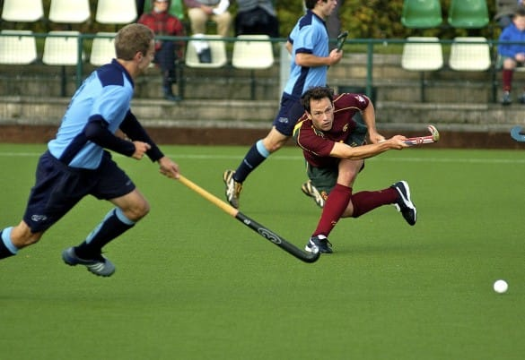 hockey players in action on turf surface