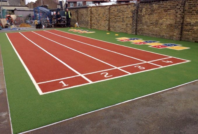 small nursery running track with hopscotch
