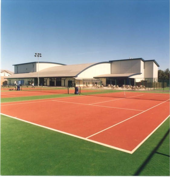 sports club with outdoor rust tennis court