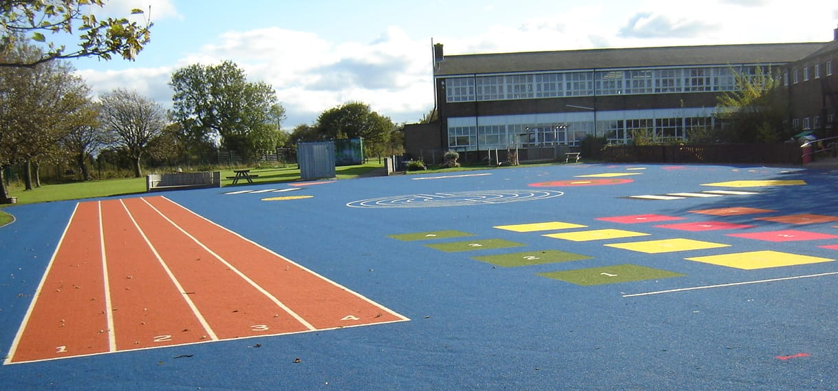 primary school playground with bespoke designs and running track