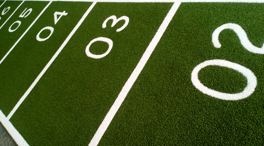 number markings on artificial grass performance track in green and white