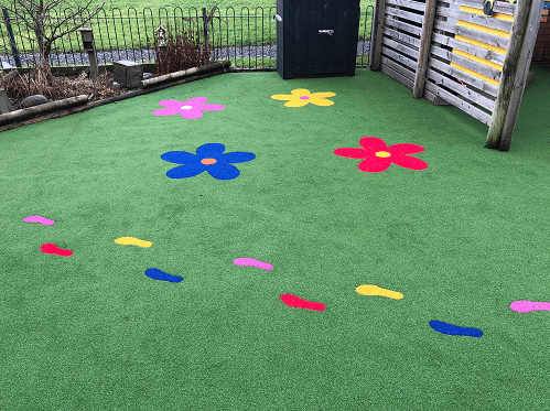 flowers and footprints in artificial turf playground