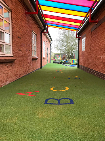 playground canopy area with artificial turf flooring