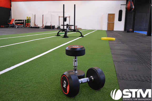 gym equipment on artificial grass sled track