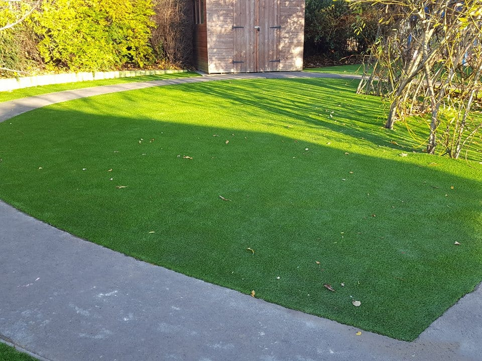 artificial grass landscaping at school in the sunshine