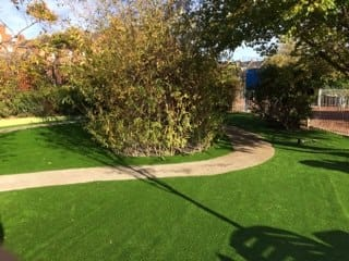 finished artificial grass landscaping install with path running through
