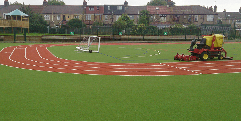 artificial turf maintenance on athletics grass
