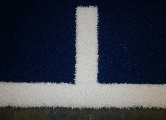 close up view of artificial turf in blue and white
