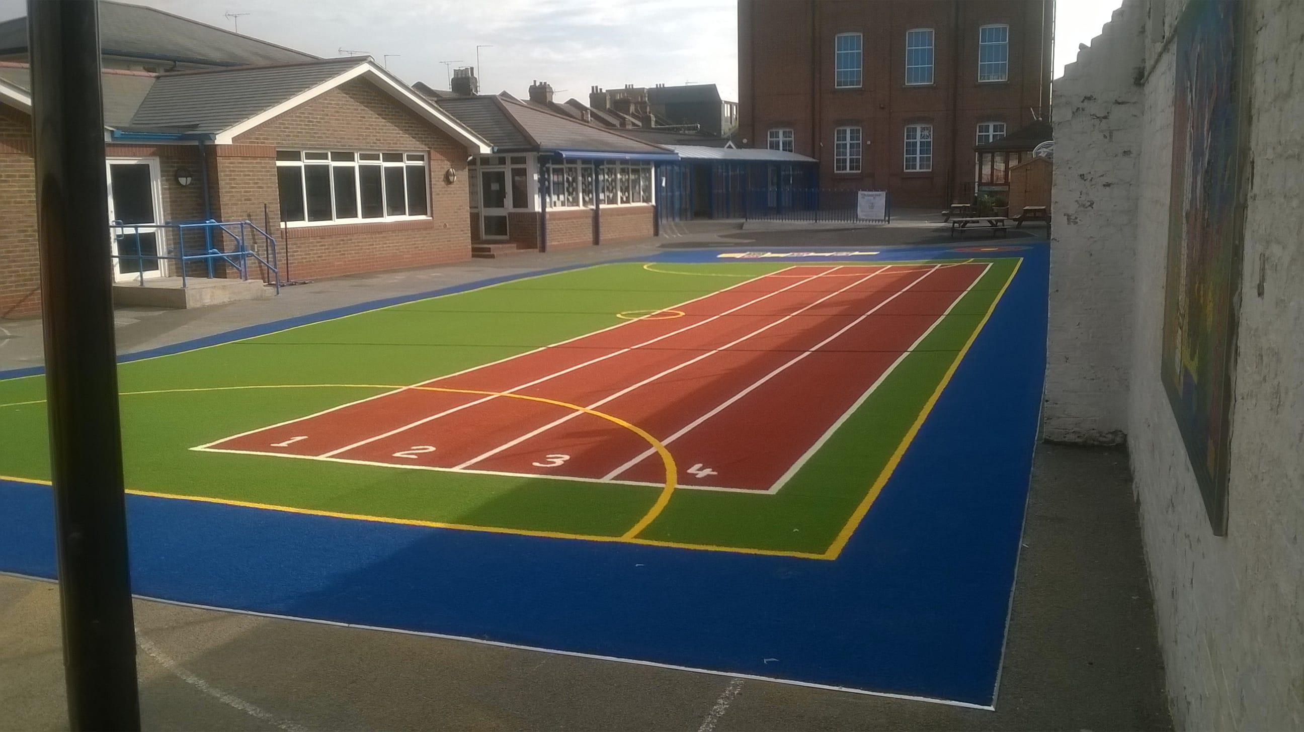 Classroom Design Standards Uk ~ Good shepherd primary school playground surface · stm world
