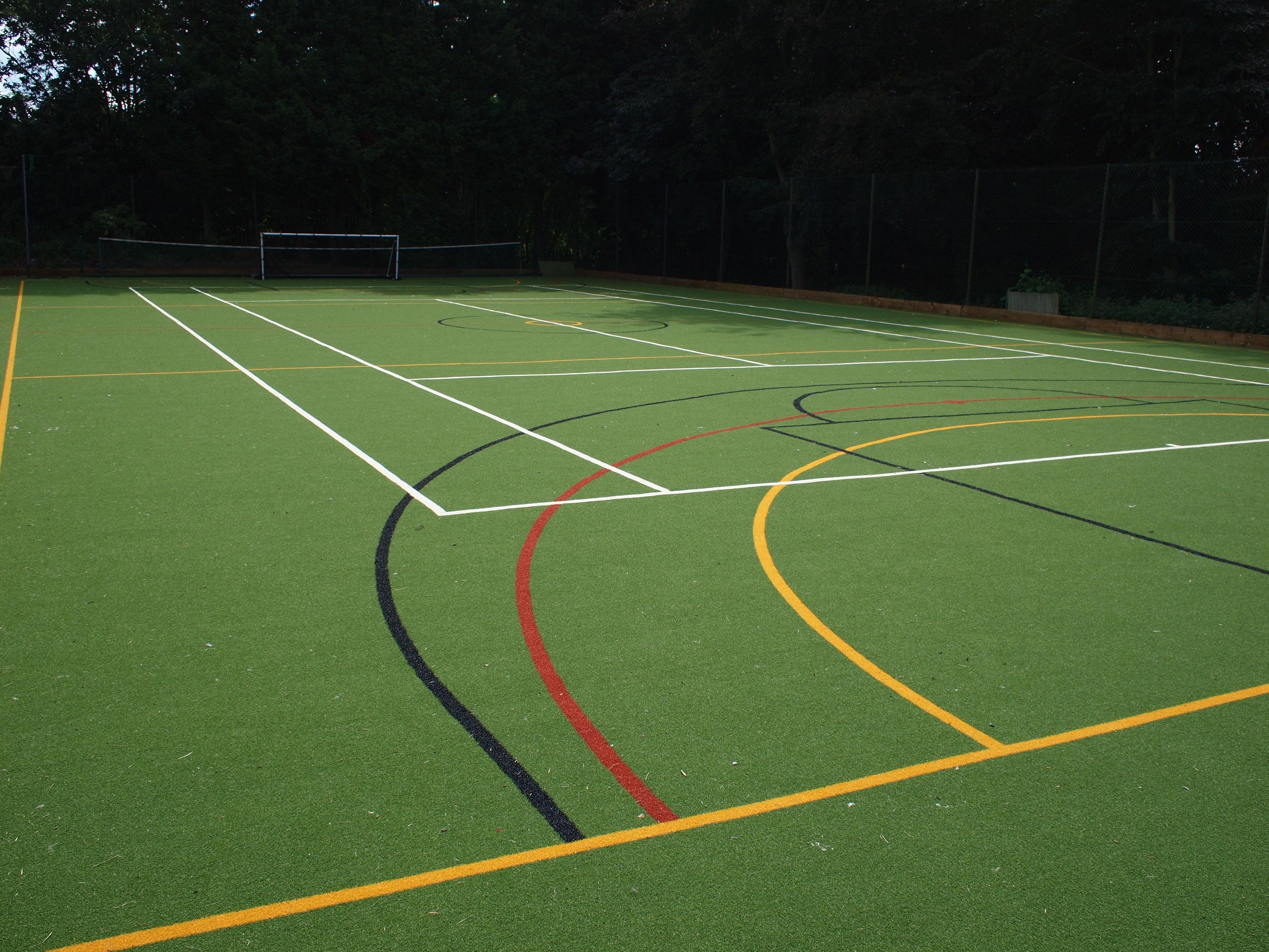 Green MUGA with white, black, red and yellow line markings