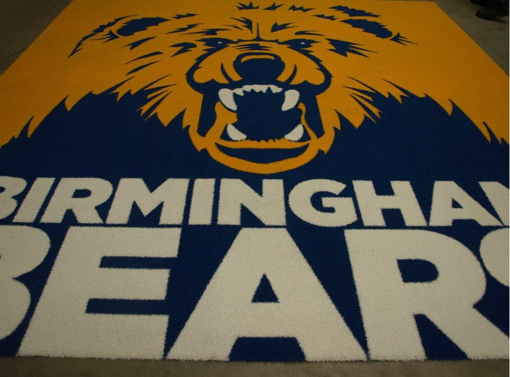 Birmingham Bears logo transformed into astroturf mat