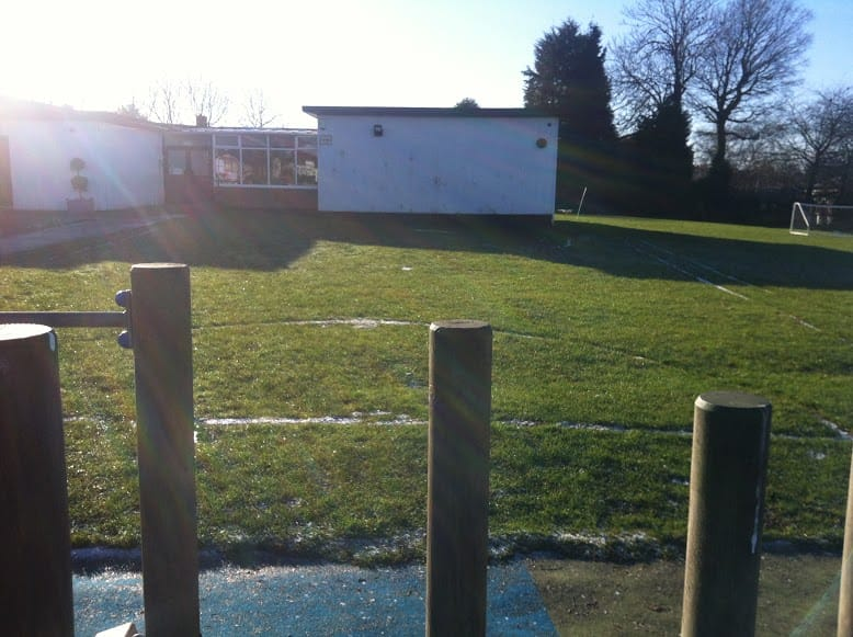 muddy school field- before new project
