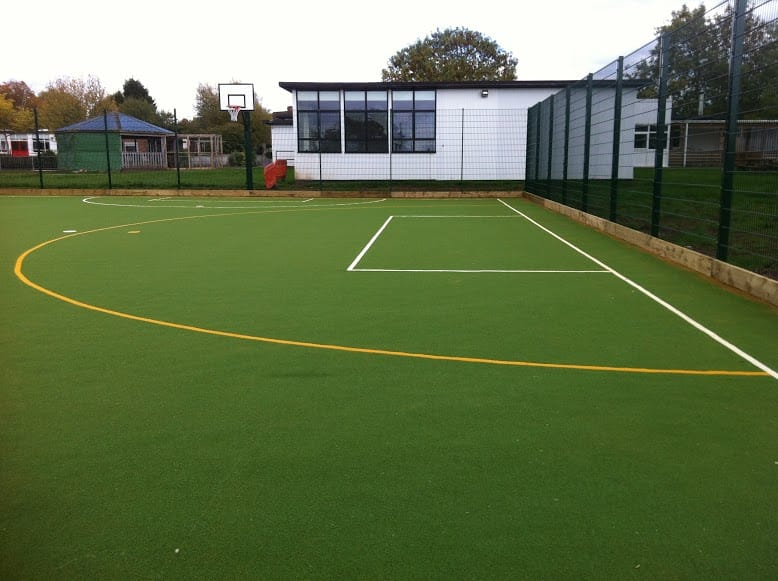 MUGA constructed with synthetic turf in green with sport markings