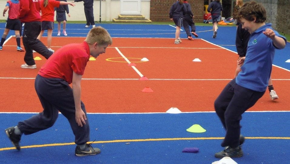 pupils in PE on school muga