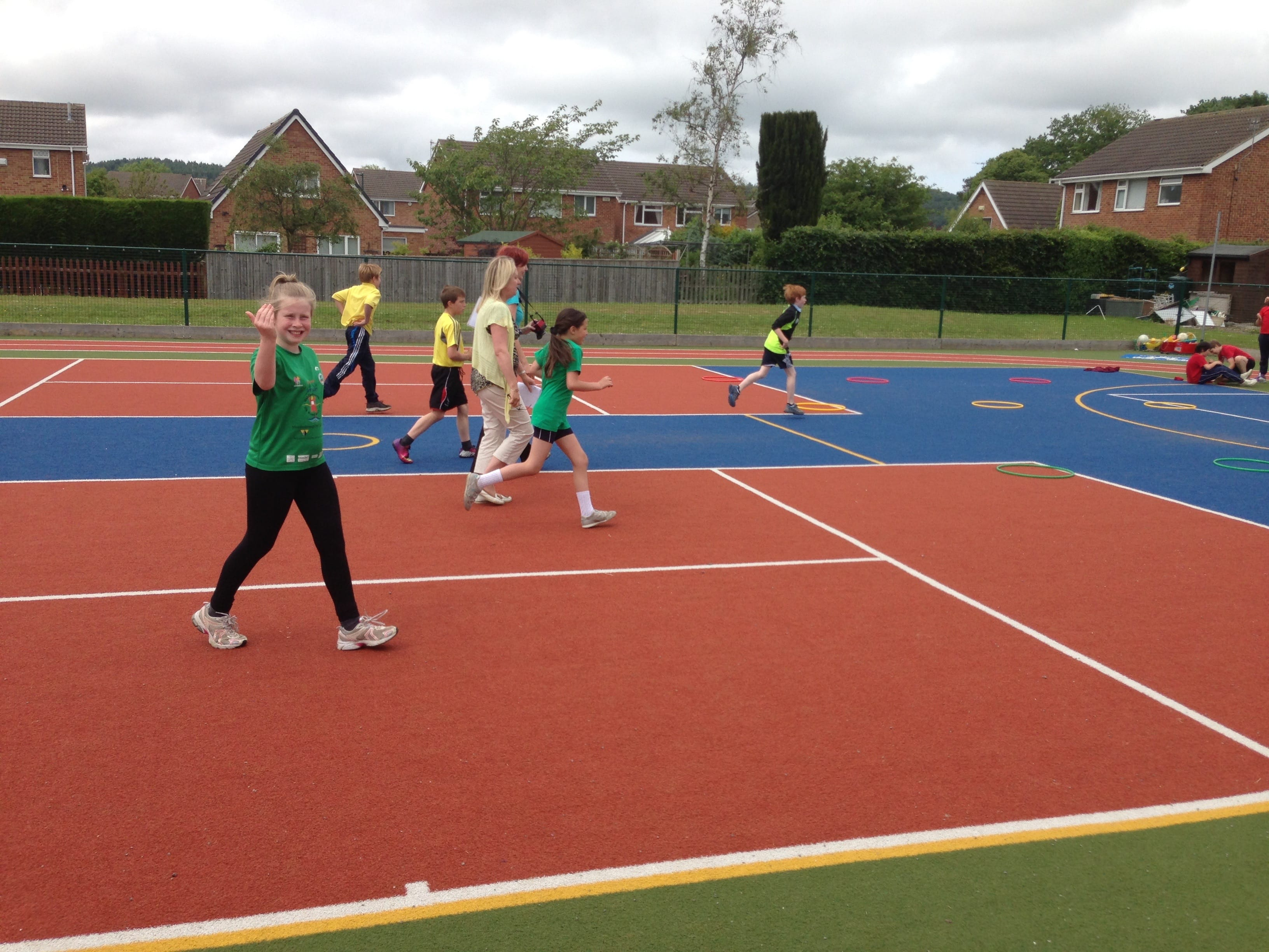 children in pe using artificial grass muga