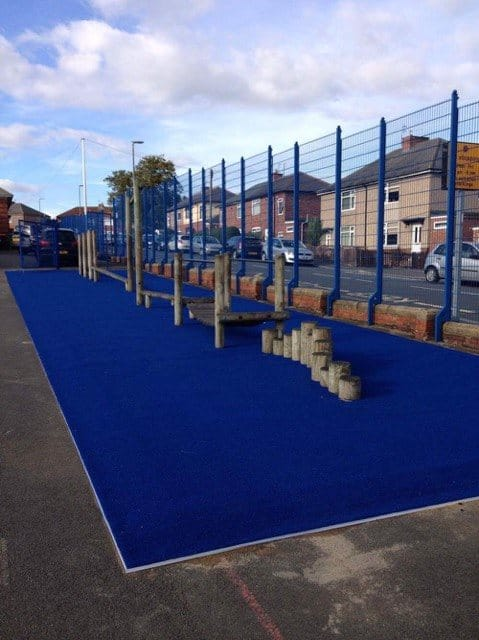 blue artificial turf in replacement of natural grass surface shows clean and tidy play area