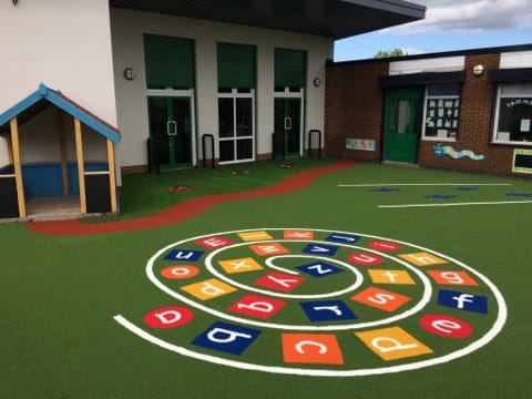 multi coloured alphabet swirl in artificial turf