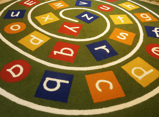 synthetic turf alphabet swirl with square multicoloured letters