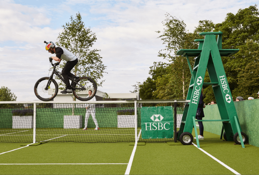 Danny Macaskill performing stunt on top of the Wimbledon tennis net