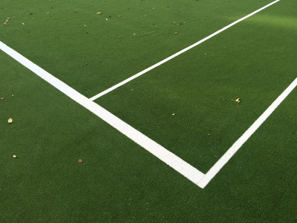 corner of synthetic turf tennis surface